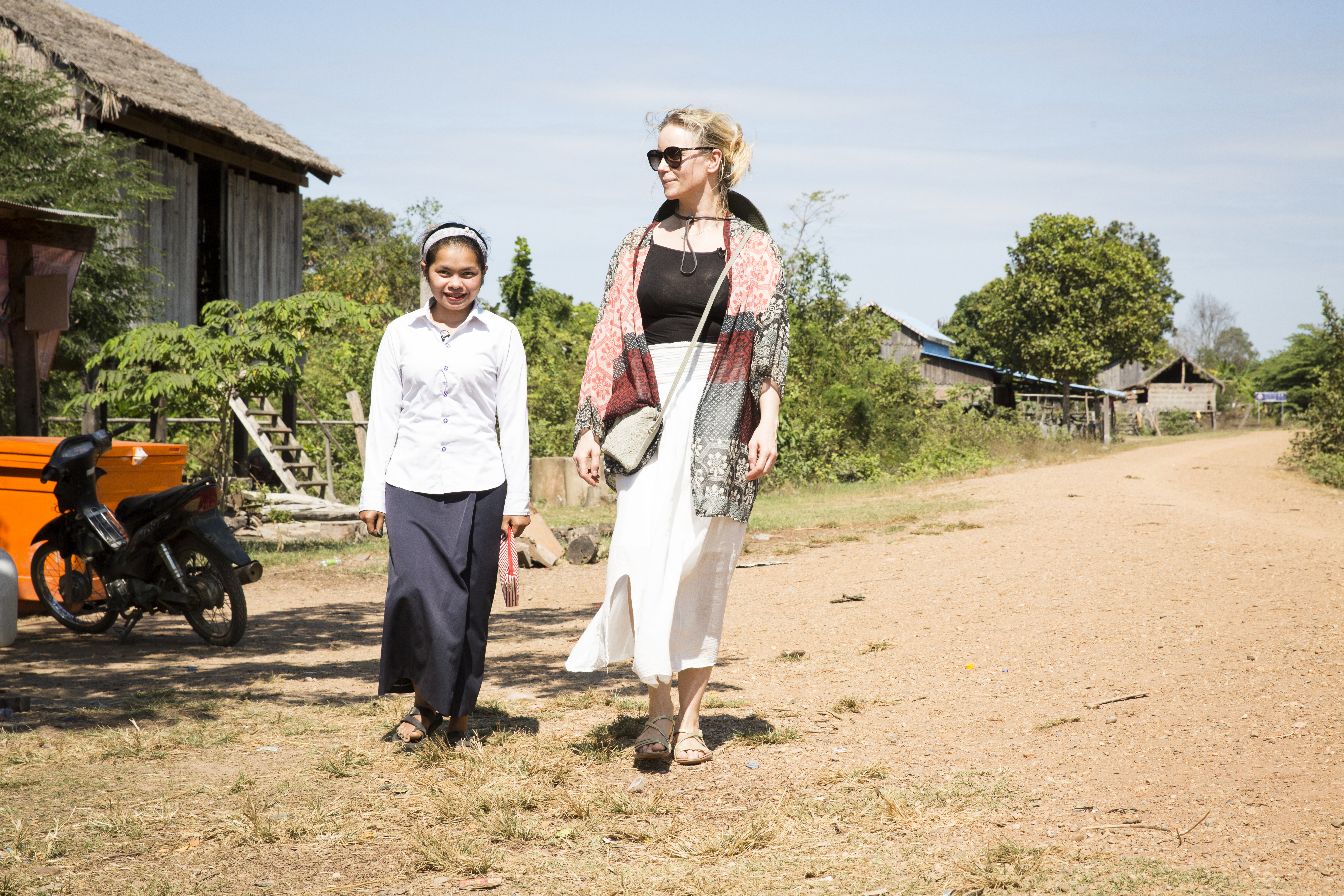 Sofia Helin, WaterAid Ambassador, chats with Rom Rachana, a teacher at the Primary School in the village of Kampong Pnov.