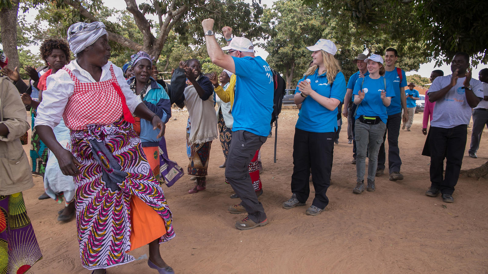 Edited Thames Water employees dancing with the community in Malawi.