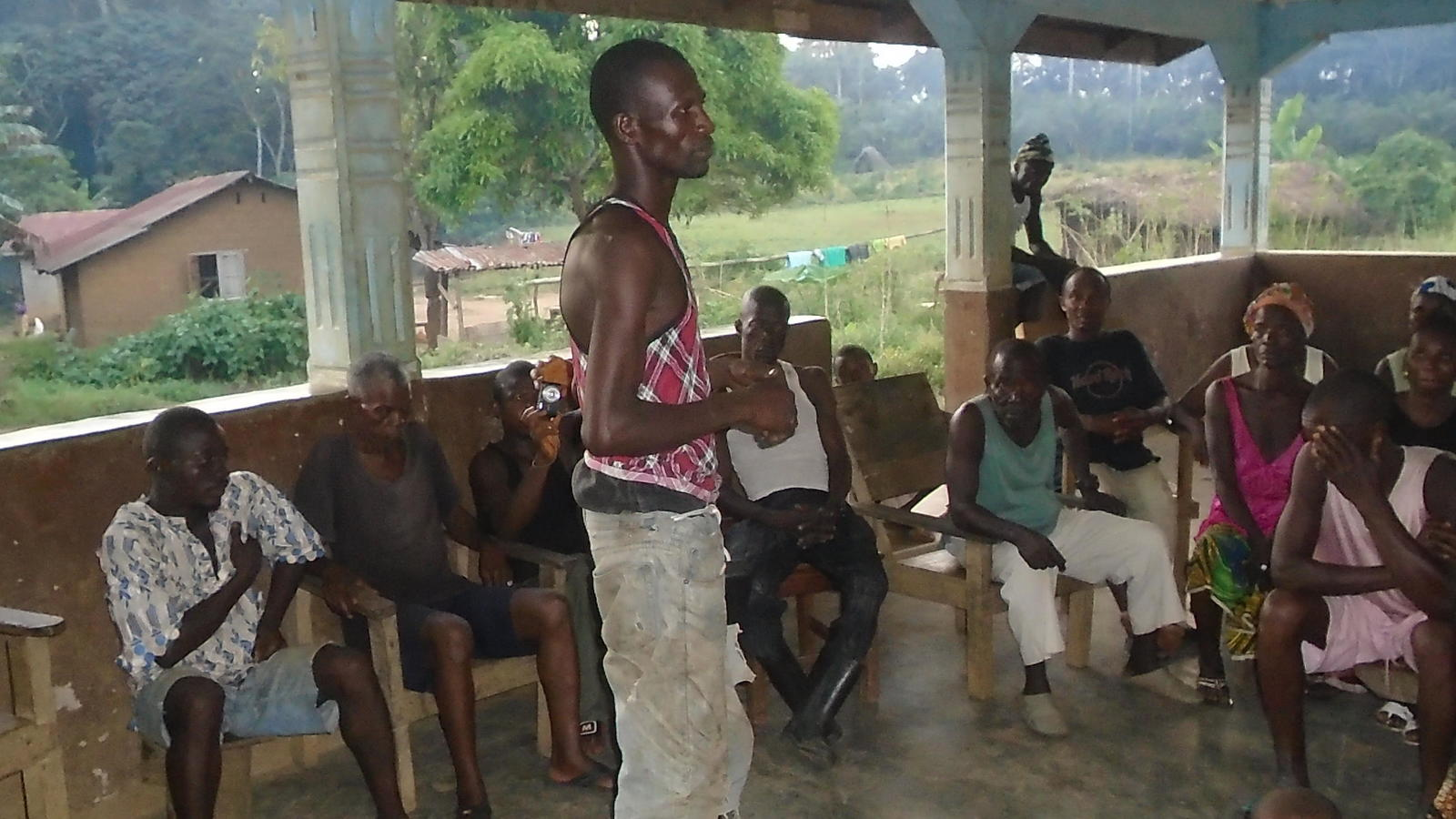 A meeting of the villagers discussing cleaning in Tombohuaun.
