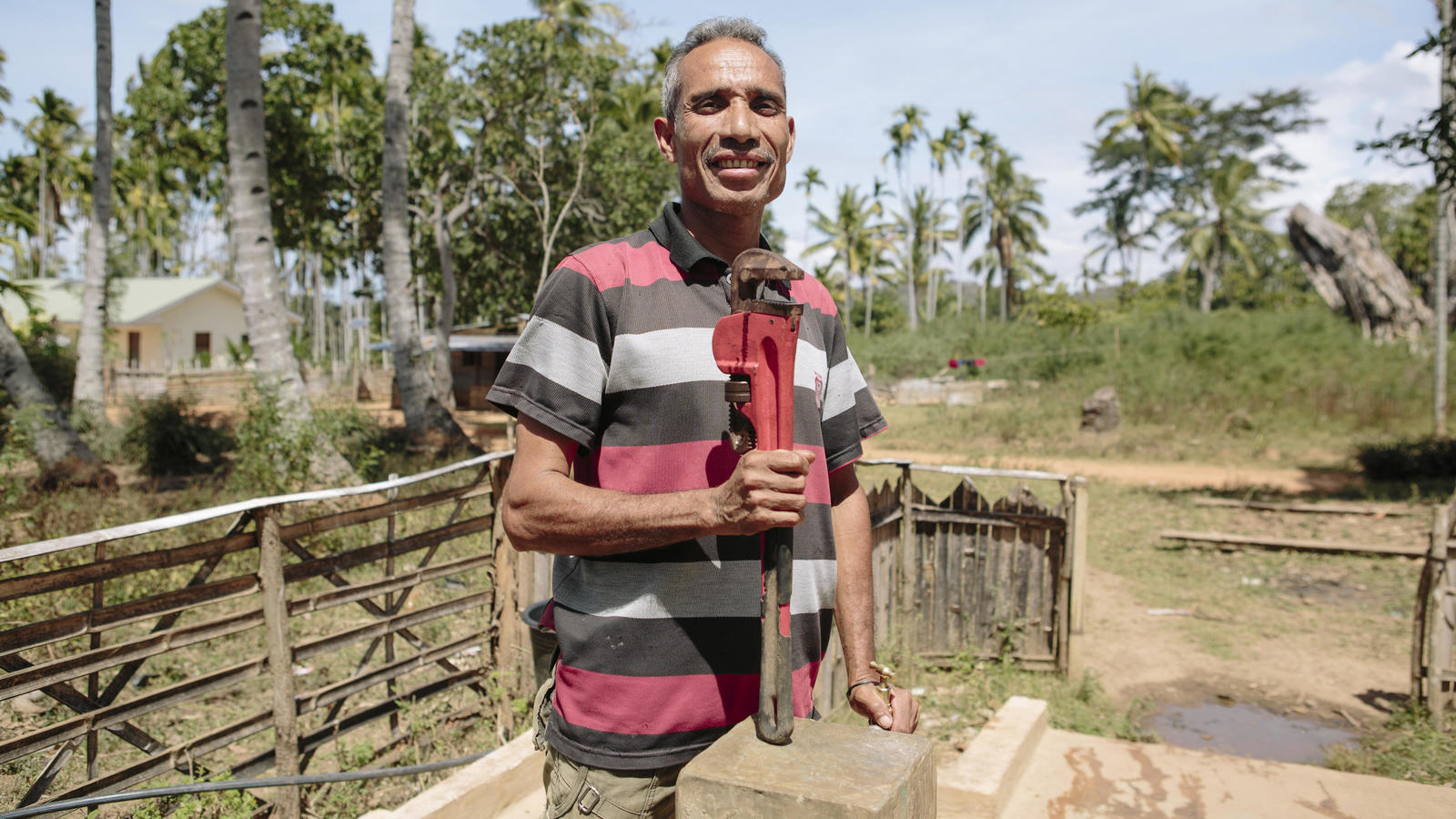 Filomeno, a member of his village's Water Committee, at one of the new tap stands in Grotu, Timor-Leste.