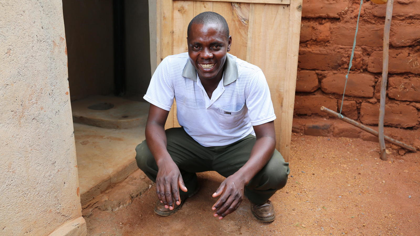 Rongin is one of the first people to own an ECO-SAN toilet in his village in Rwanda.