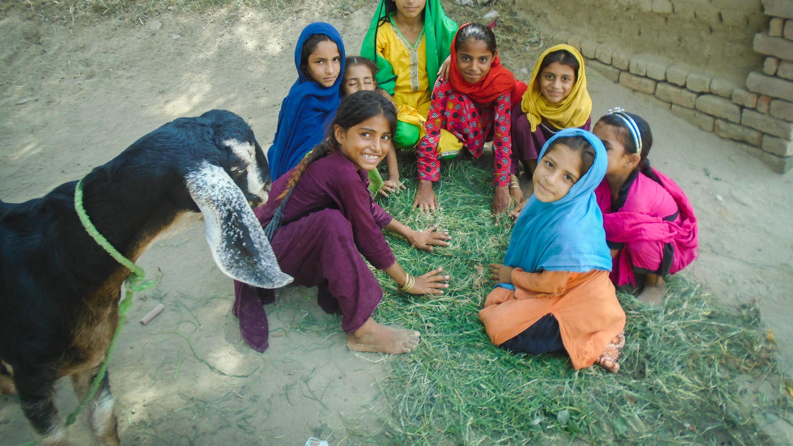 Aleena, 7, playing with her friends in the village of Waan Pitafi, Pakistan.