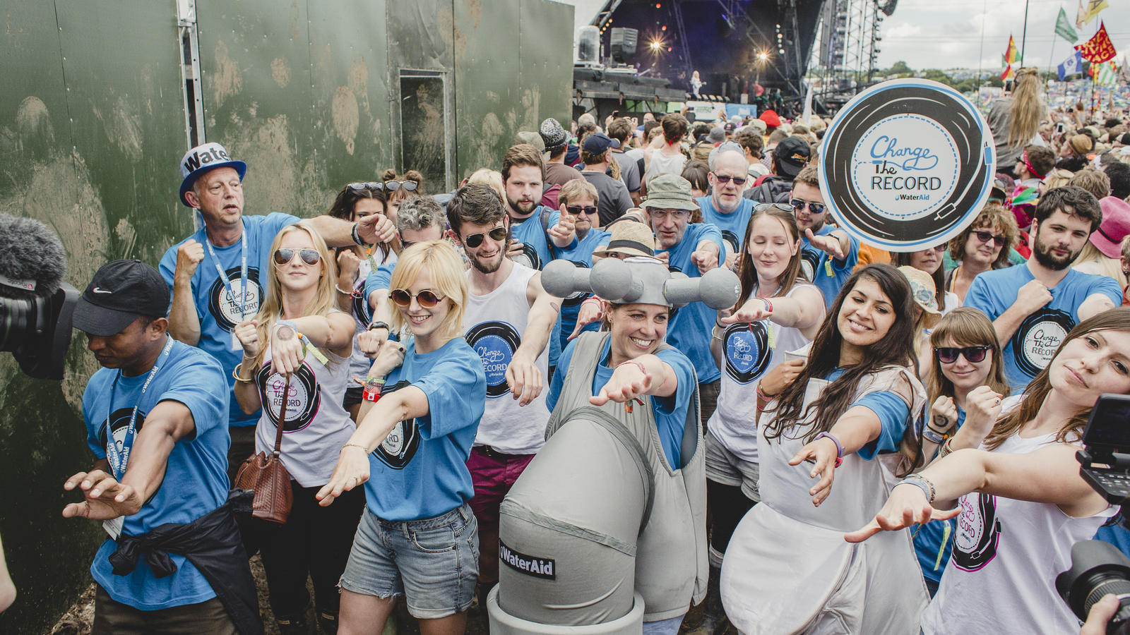 Anna Hedges and WaterAid volunteers, in a flashmob in front of the Pyramid Stage, Glastonbury