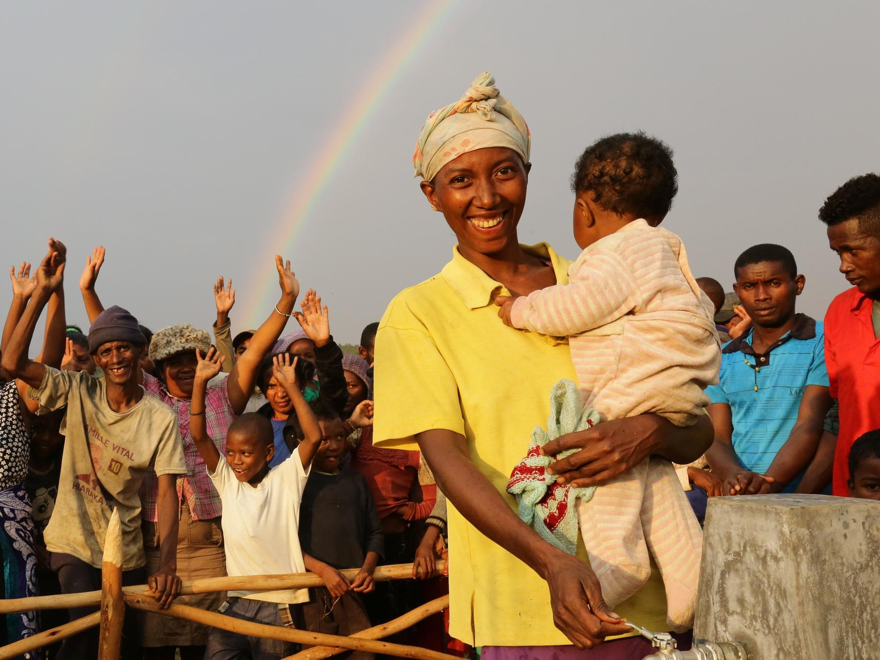 A happy group photo of villagers in Madagascar with Raoly, and her baby girl, Natasha.