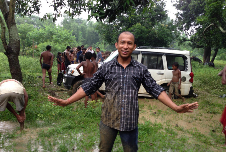 Mani gets help from locals when his vehicle gets stuck in mud.