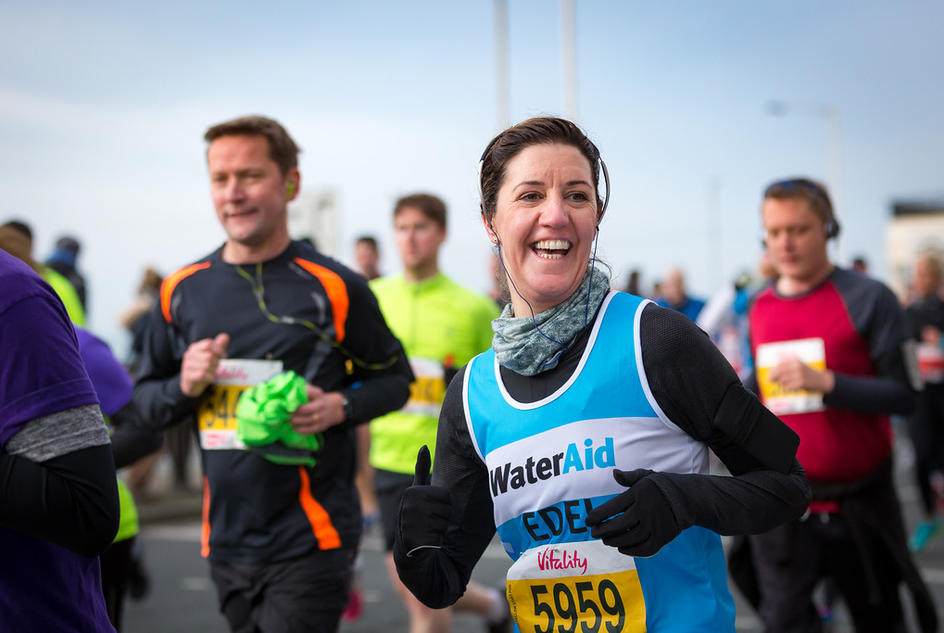 A runner with a WaterAid charity place taking part in the Hackney Half Marathon