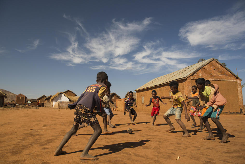 Boys from Beanamamy village playing soccer, the soccerball is made out of plastic bags and rope. Bevato  commune, Tsiroanomandidy district, Bongolava region, Madagascar, October 2018.