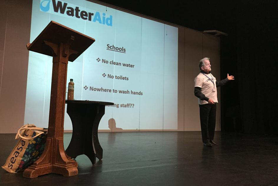 Geoff during a talk about WaterAid's work to a school