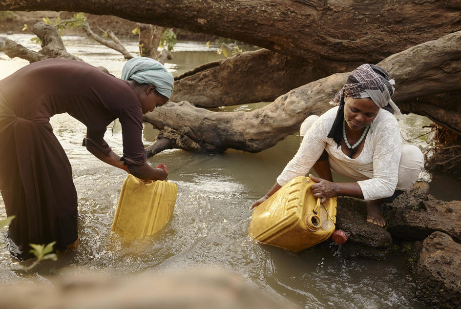 Hawa (right) with her daughter Kadija (left) collecting water from the River Lah in Frat, Ethiopia.