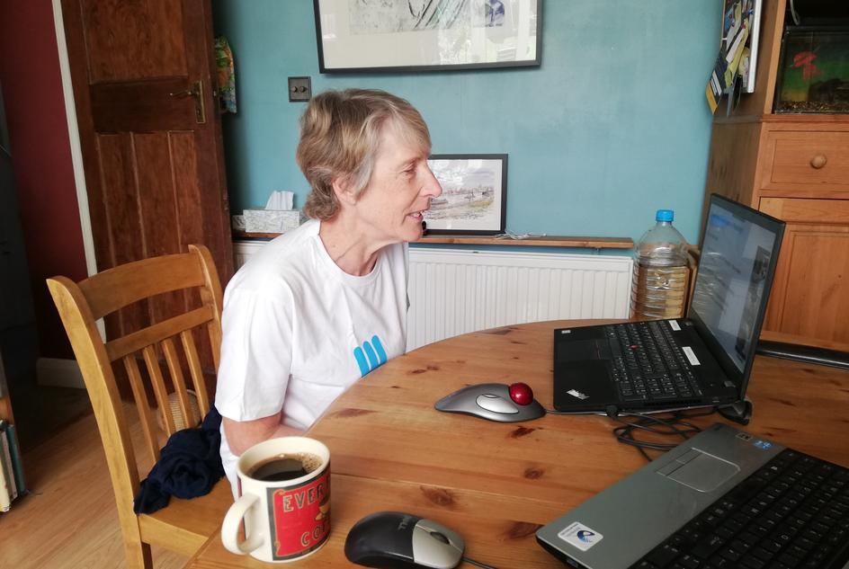 Penelope Smith, delivering an online talk and workshop for Scouts from her home.