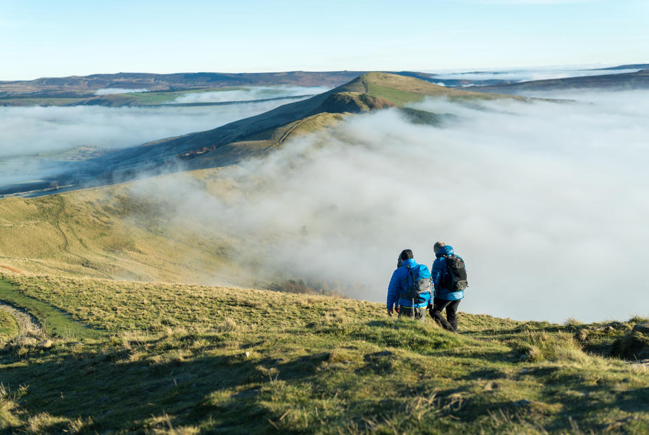 Two hikers on a hilltop on the route of the Severn Trent Mountain Challenge