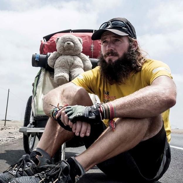 Jamie Ramsay taking a rest during his run from Vancouver to Buenos Aires for WaterAid and other charities.