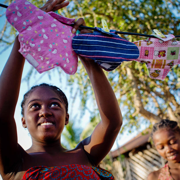 Julianna hangs up her cotton sanitary towels to dry after washing them. Madagascar, April 2016.( Photo/KATE HOLT)