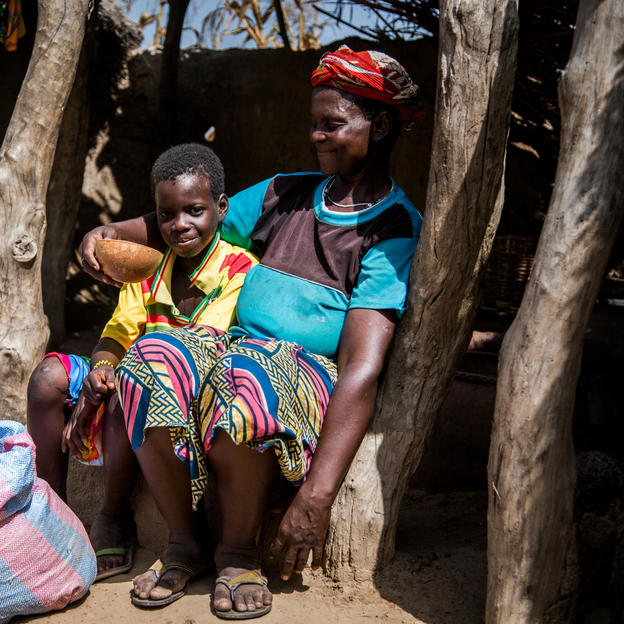 Josephine gives her daughter Ratba a drink of water at their home in Burkina Faso