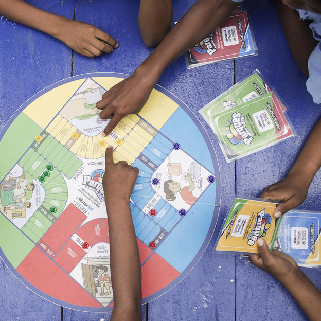 Kids at school play with WaterAid's parcheesi, at Maicao, La Guajira, Colombia. March 2017.