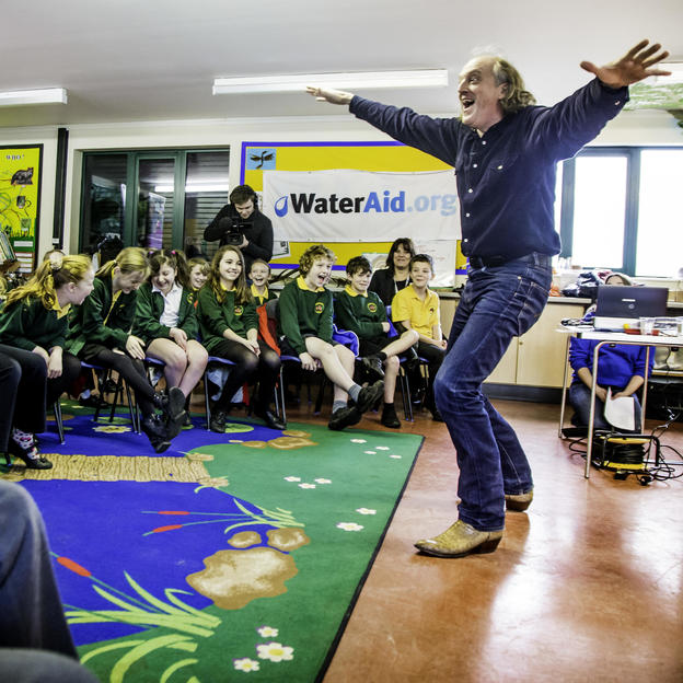 Children celebrate the launch of the WaterAid poetry competition, Hampshire, UK, 2013.