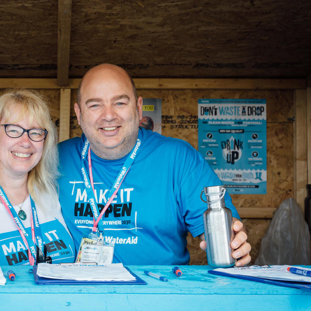 WaterAid volunteers man a water kiosk, Glastonbury, 2015.