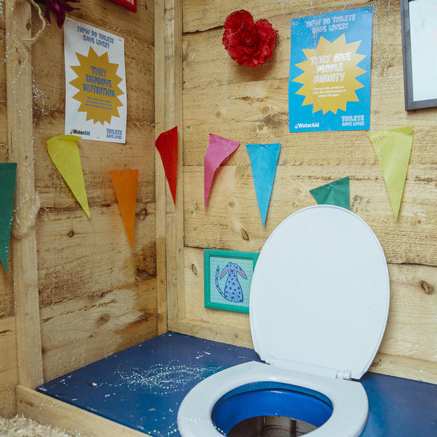 The interior of a WaterAid 'Talking Toilet' at Glastonbury Music Festival.