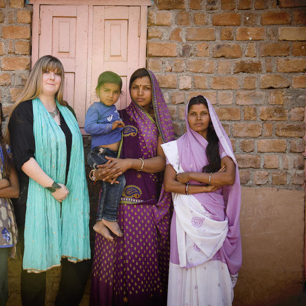 Jane (centre) stands with Babita (far right) and members of Babita's family outside their home in Uijain, India.