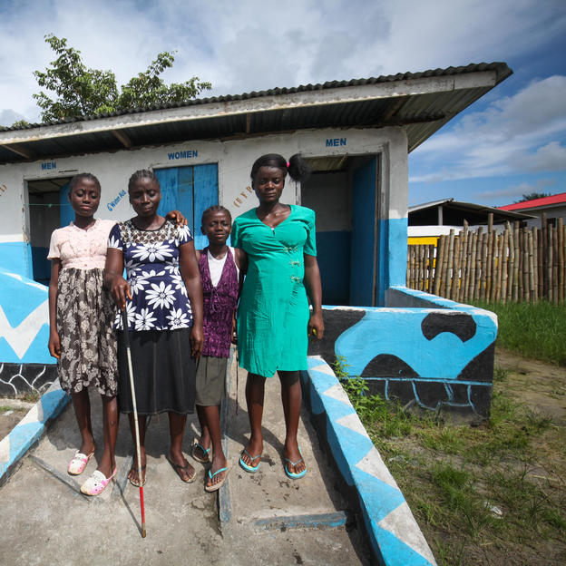 From left to right: Beshida, Sarah, Jestina and Janet at the disabled-friendly toilet, built by WaterAid's partners, in the Weinzon Community, Liberia