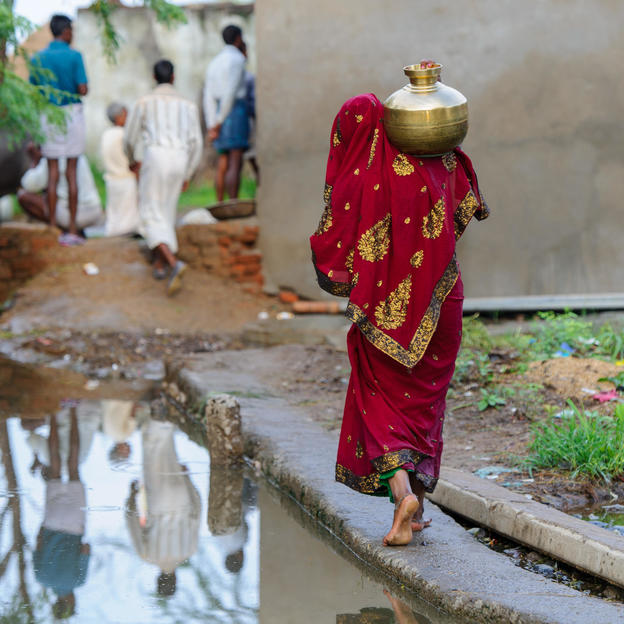 A woman collects water in the Narai Ka Pura, India.