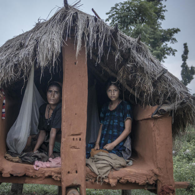 Mangu, 14, shares the chaupadi hut with Chandra, 34, to sleep in, Nepal.