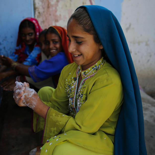 Najma (9) washes her hands with soap; using water from a newly installed WaterAid supported WASH facilities in Sindh Province, Pakistan.