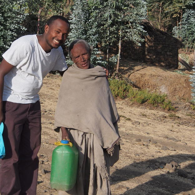 Behailu smiles for a photo with 80-year-old Birhane in Tigray, Ethiopia.