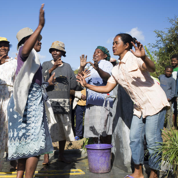 Women celebrating water arriving in their village at one of their water points in Madagascar.
