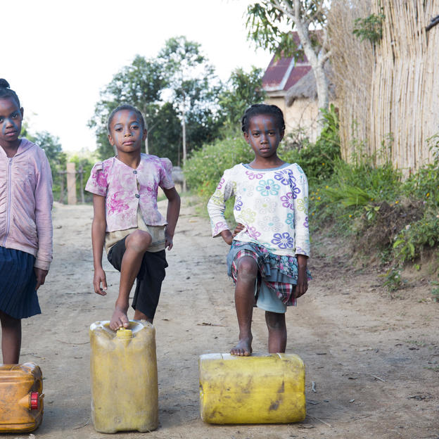 Esteffy, Tahiana, and Lanja, 9, posing as water warriors in Alaotra Mangoro region, Madagascar.