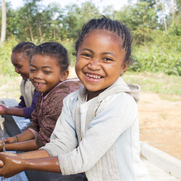 Cynthia with some of her classmates washing hands at the handwashing station of their school in Madagascar.