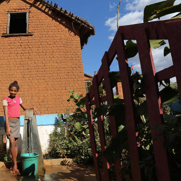 Aurelia, fetching water at the new water point in her village, Bongolava region, Madagascar.