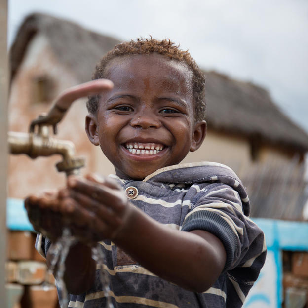 """I am happy as it is so easy to get water from the tap"" Happy portrait of Mamisoa, 6, at one of the three fountains in Ambohijafy Village, Ankazobe District, Analamanga Region, Madagascar."