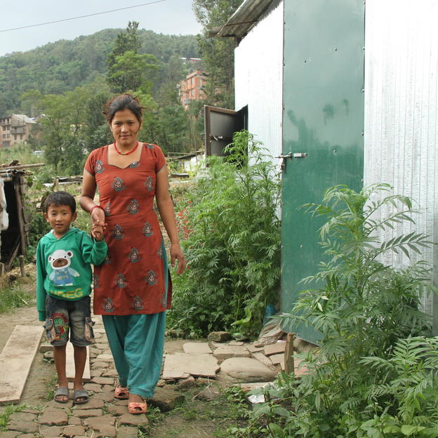 Sarmila taking her son to the toilet. Nepal.