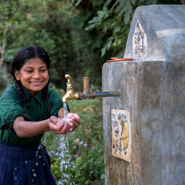 Laxmi washing hands in the tapstand near her home in Nepal, Feb 2017.