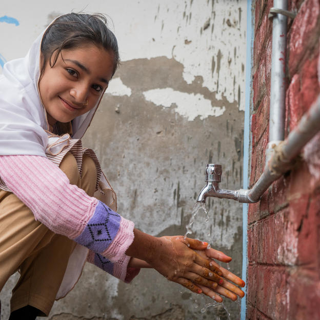 Urusa, 12, washing hands at the WASH facility in Government Elementary School in the village of Khan Sahib Abdul Rehman, Union Council Luari Sharif, District Badin, Sindh, Pakistan, January 2017