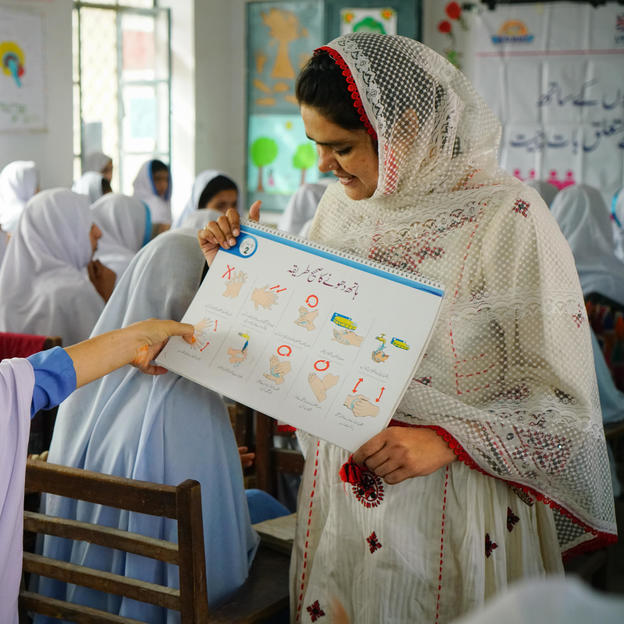 A hygiene session takes place at a school in Pakistan.