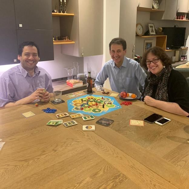 A group of friends playing a board game together