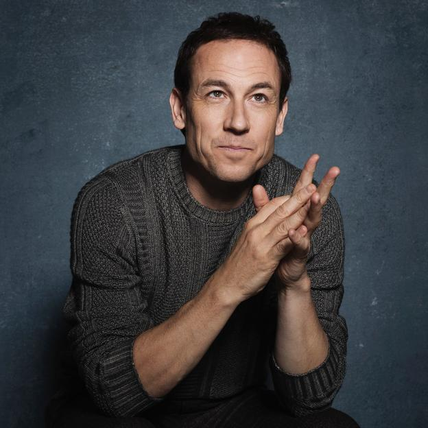 A headshot of Tobias Menzies