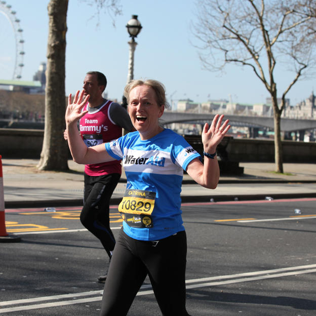 A WaterAid runner running the London Landmarks Half Marathon route