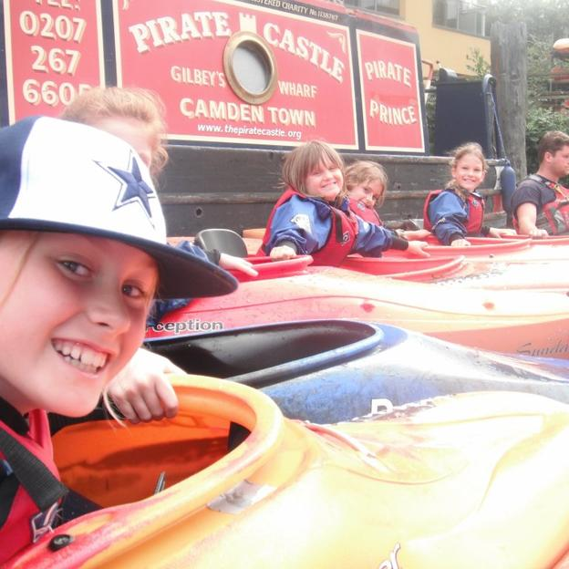 Children from the Pirate Castle in their kayaks