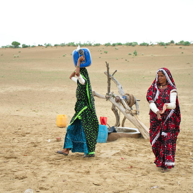 Women fetch water from a well nearby there village in Pakistan.