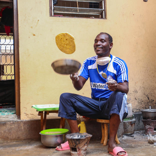 James Kiyimba flipping the chapati in the air. Covid-19 response. Lockdown Diaries - James Kiyimba. Uganda. May 2020