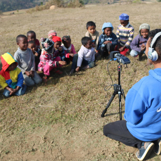 Ernest recording the sound of Malagasy children singing and playing for WaterAid's Alexa skill