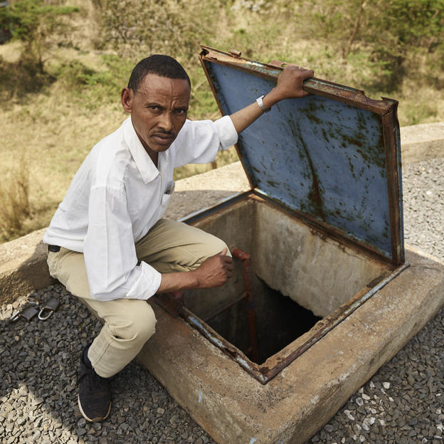 Leyew Animut gaining access to the water tower in Finote Selam, Ethiopia, February 2020