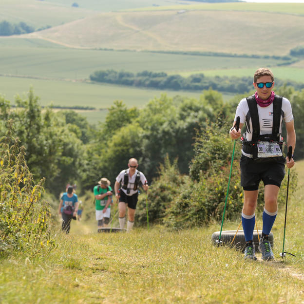 Racers heading up a hill as part of the Race to the King ultra marathon route