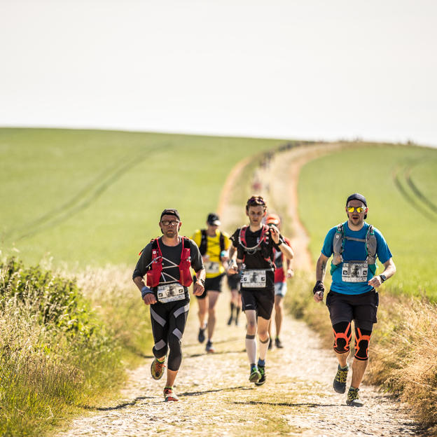 Racers running through the South Downs during Race to the King