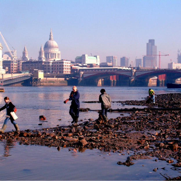 Volunteers from Thames 21 clean up the river near the city of London