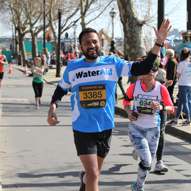 WaterAid runner taking part in the London Landmarks Half Marathon, London, U.K. March 2019.
