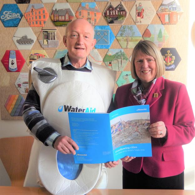 WaterAid supporter Mark, dressed as a toilet, meets MP Fiona Bruce.